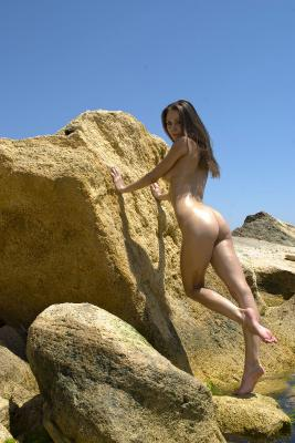 Cute amateur girl naked on exotic beach