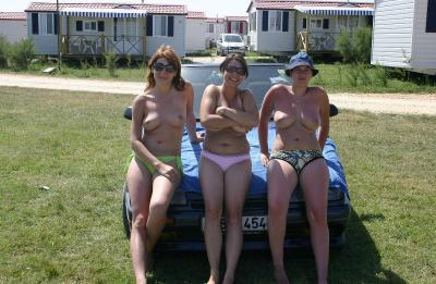 Three girls show their boobs